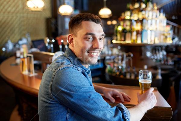happy man drinking draft beer at bar or pub Stock photo © dolgachov