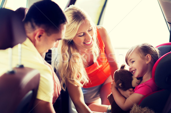 happy parents with little girl in baby car seat Stock photo © dolgachov