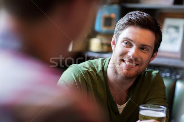 happy man with friend drinking beer at bar or pub Stock photo © dolgachov