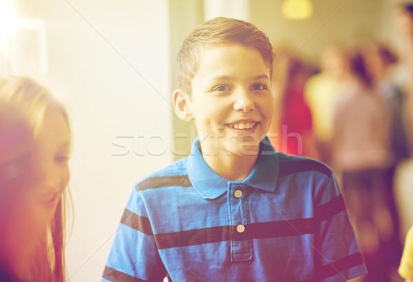 group of smiling school kids in corridor Stock photo © dolgachov
