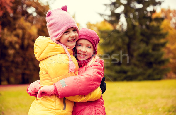 two happy little girls hugging in autumn park Stock photo © dolgachov