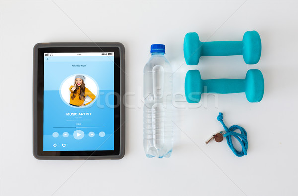 tablet pc, dumbbells, whistle and water bottle Stock photo © dolgachov