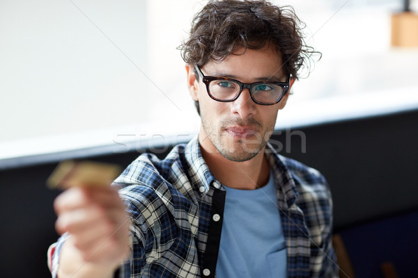 happy man paying with credit card at cafe Stock photo © dolgachov