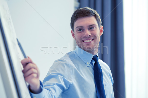 Stock photo: smiling businessman on presentation in office