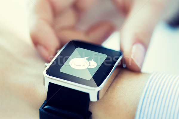 close up of hands with message icon on smartwatch Stock photo © dolgachov