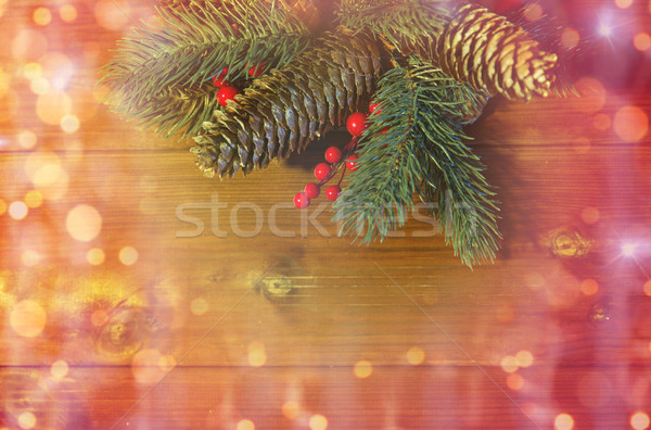 Stock photo: close up of fir branch with cones on wooden table