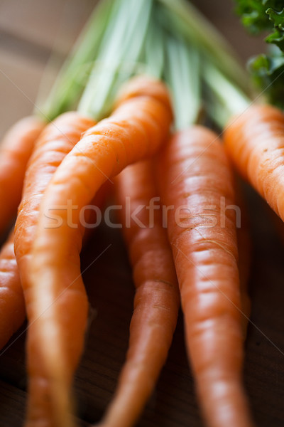 close up of carrot bunch on wooden table Stock photo © dolgachov