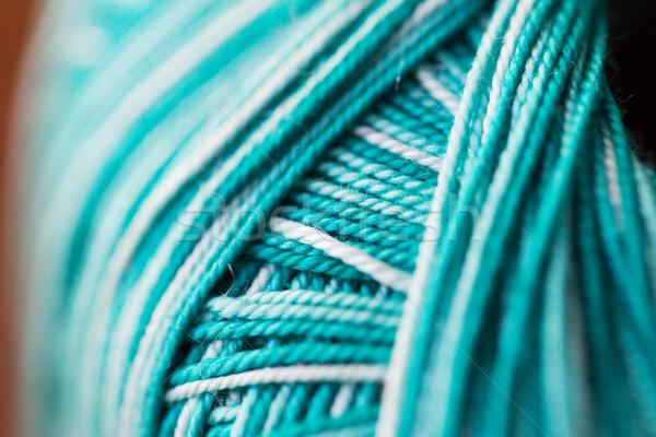 close up of turquoise knitting yarn ball Stock photo © dolgachov