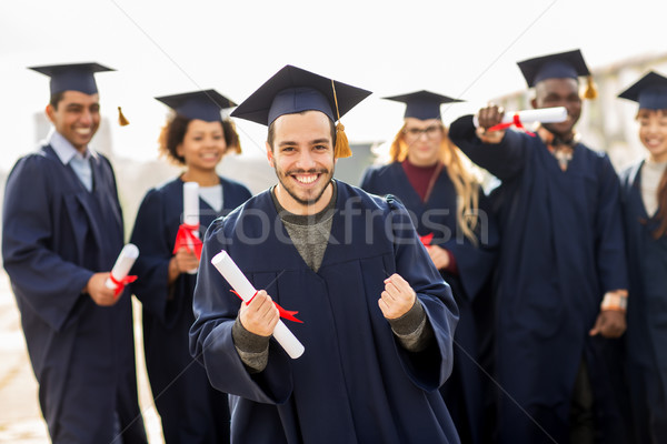 happy student with diploma celebrating graduation Stock photo © dolgachov