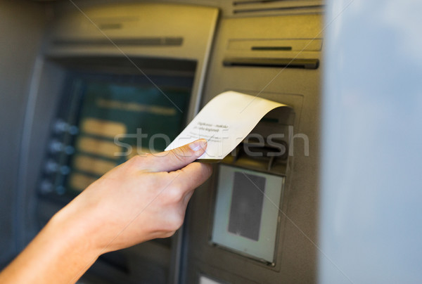 close up of hand taking receipt from atm machine Stock photo © dolgachov