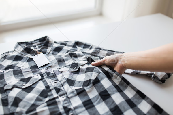 close up of hand and shirt with price tag Stock photo © dolgachov