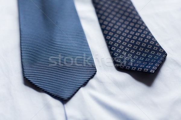 close up of shirt and blue patterned ties Stock photo © dolgachov