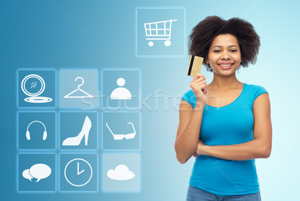 afro american woman with credit card and icons Stock photo © dolgachov