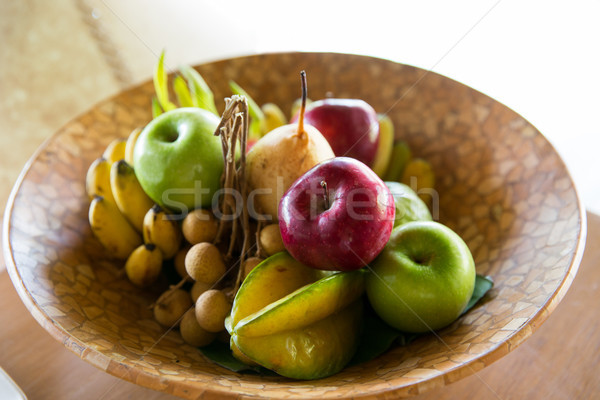 still life with exotic tropical fruits in bowl Stock photo © dolgachov