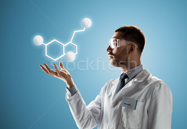 scientist in safety glasses with molecular formula Stock photo © dolgachov