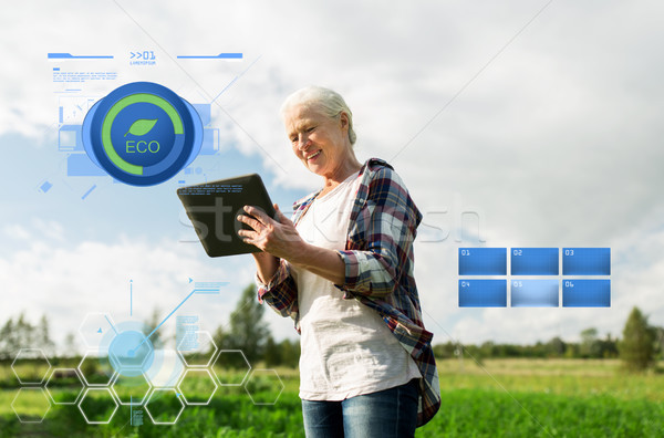 senior woman with tablet pc computer at county Stock photo © dolgachov