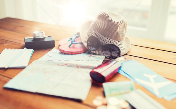 close up of travel map, tickets, money and stuff Stock photo © dolgachov