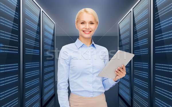 businesswoman with tablet pc over server room Stock photo © dolgachov