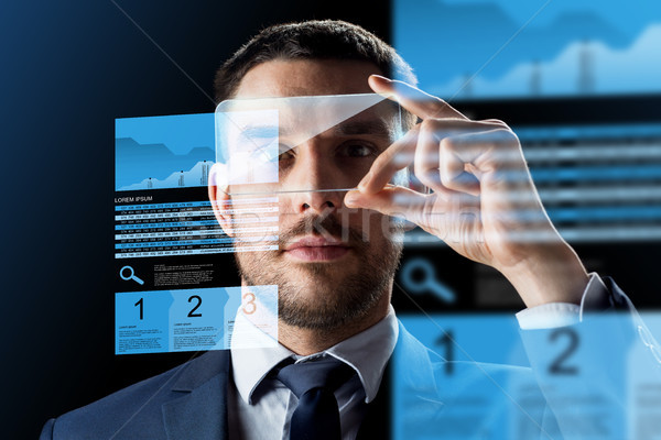 Zakenman smartphone uitwisseling charts business realiteit Stockfoto © dolgachov