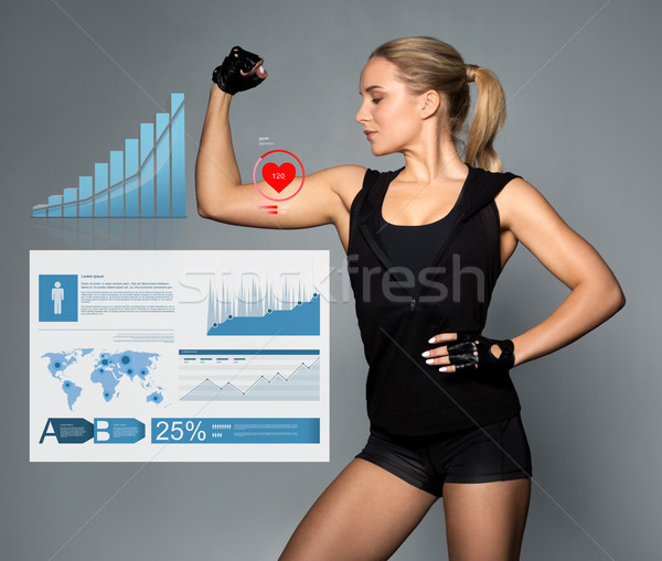 young woman showing muscles with charts and pulse Stock photo © dolgachov