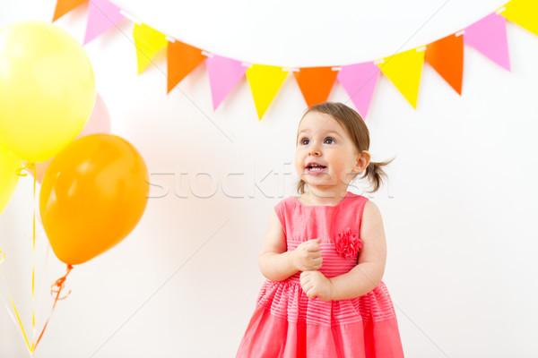 happy baby girl on birthday party Stock photo © dolgachov