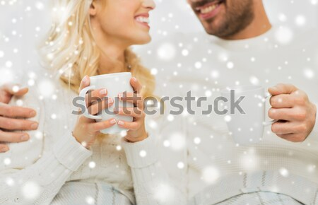 close up of happy woman with cup of cocoa at home Stock photo © dolgachov