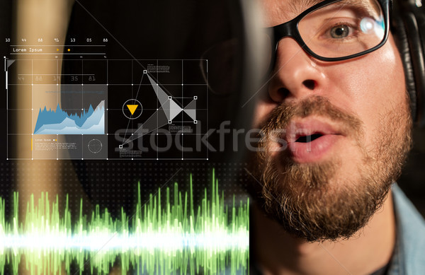man singing at sound recording studio Stock photo © dolgachov