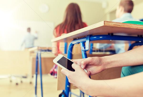 Diák fiú okostelefon sms chat iskola oktatás Stock fotó © dolgachov