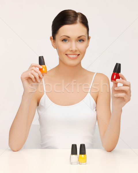 woman with nail polish bottles Stock photo © dolgachov