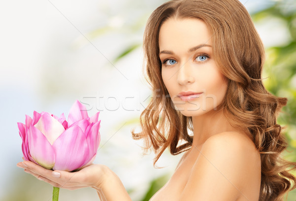 lovely woman with lotos flower Stock photo © dolgachov