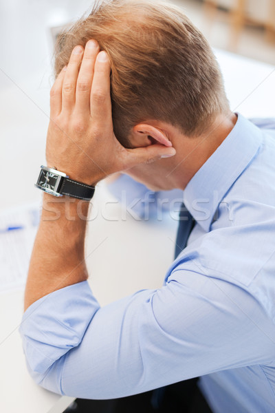 stressed businessman with papers at work Stock photo © dolgachov
