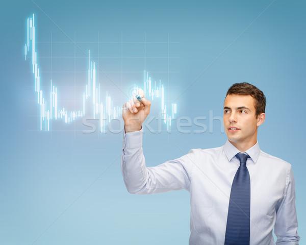 attractive buisnessman or teacher with marker Stock photo © dolgachov