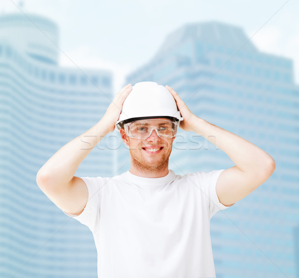 Stock photo: male architect in helmet with safety glasses
