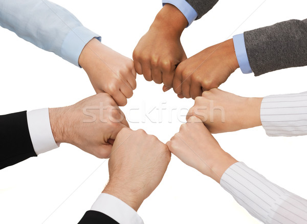 closeup of businesspeople hands in fists in circle Stock photo © dolgachov
