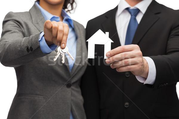 üzletember üzletasszony tart Fehér ház üzlet öko Stock fotó © dolgachov
