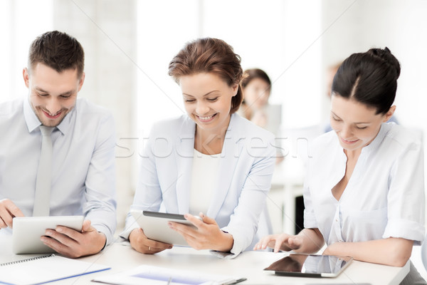 business team working with tablet pcs in office Stock photo © dolgachov