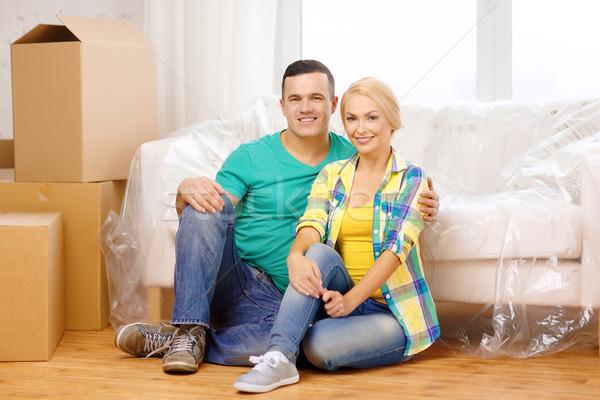 Mosolyog pár ül padló új ház mozog Stock fotó © dolgachov
