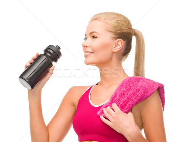 sporty woman with special sportsman bottle Stock photo © dolgachov