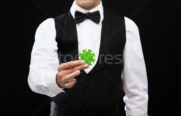 Kereskedő tart zöld póker chip mágikus Stock fotó © dolgachov
