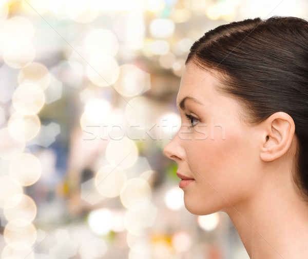 profile portrait of young woman Stock photo © dolgachov