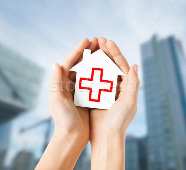 Manos papel casa cruz roja salud Foto stock © dolgachov