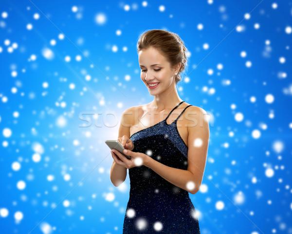 Sorrindo vestido de noite tecnologia comunicação inverno Foto stock © dolgachov