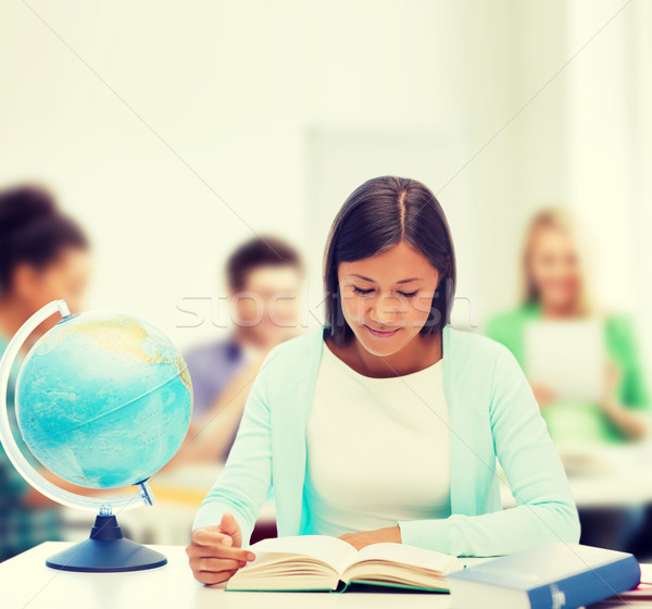 teacher with globe and book at school Stock photo © dolgachov
