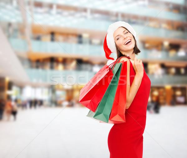 Kadın kırmızı elbise satış hediyeler Noel Stok fotoğraf © dolgachov