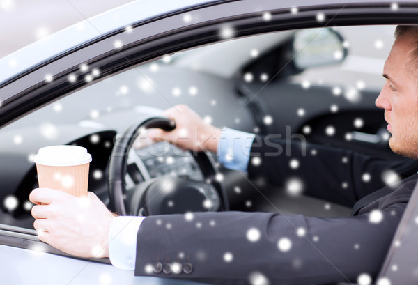 Stock photo: close up of man drinking coffee while driving car