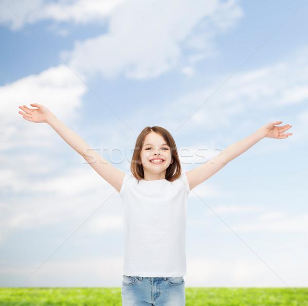 笑みを浮かべて 女の子 白 Tシャツ 広告 幼年 ストックフォト © dolgachov