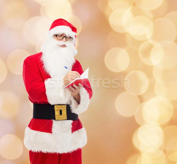 Man kostuum kerstman notepad christmas vakantie Stockfoto © dolgachov