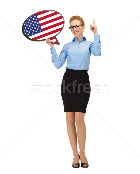 Stockfoto: Glimlachende · vrouw · tekst · bubble · Amerikaanse · vlag · onderwijs · buitenlands
