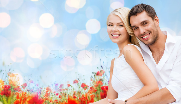 happy couple having fun over poppy flowers field Stock photo © dolgachov