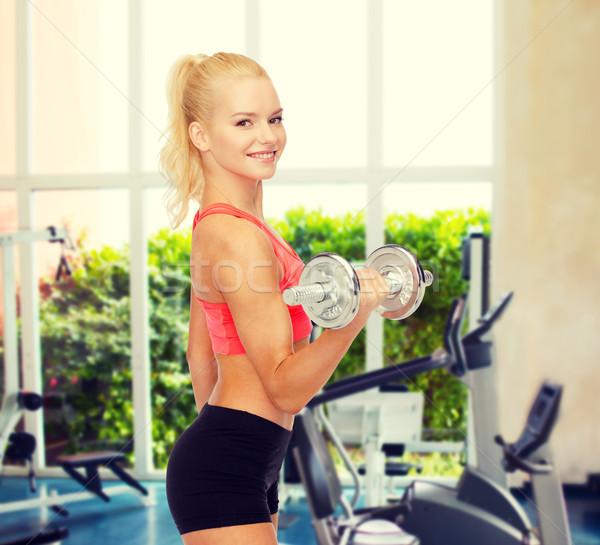 Młodych kobieta ciężki stali Zdjęcia stock © dolgachov